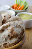 Pitta Breads with Dips Selection and Crudites on Wooden Table Royalty Free Stock Image
