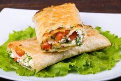 Pitta wrapped with cottage cheese and vegetables Stock Photography