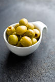 Pitted green olives in bowl Royalty Free Stock Photography