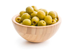 Pitted green olives in bowl. On white background stock image