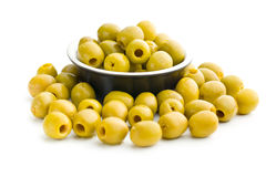 Pitted green olives in bowl Stock Photography