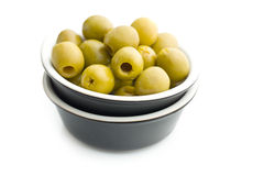 Pitted green olives in bowl Stock Photo
