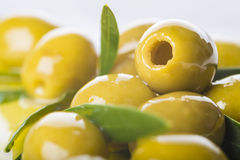 Pitted green olives with extra olive oil Royalty Free Stock Photos