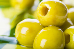 Pitted green olives with extra olive oil Stock Image