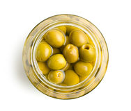 Pitted green olives. In jar royalty free stock photo