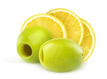 Pitted green olives and lemon Stock Images