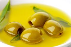 Pitted green olives Stock Photo