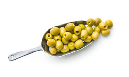 Pitted green olives in scoop. On white background stock photos