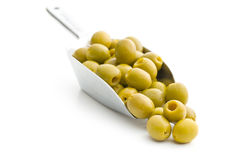 Pitted green olives in scoop. On white background stock photo