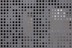 Pitted metal plate background texture. Royalty Free Stock Images