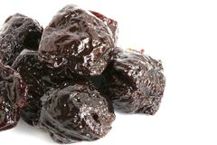 Pitted Prune. The close up shot of some pitted prunes on white background Stock Photos