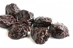 Pitted Prune. The close up shot of some pitted prunes on white background Stock Image