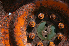 Pitted tractor wheel. A closeup image of a rusting, pitted tractor wheel royalty free stock photos