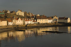 Pittenweem sunset. Picturesque fisherman's cottages in the village of Pittenweem in the East Neuk of Fife, Scotland, UK, Europe. The late afternoon sun warms the Royalty Free Stock Image