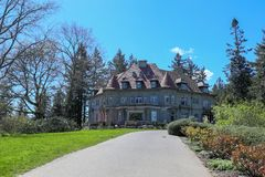 Pittock Mansion, view on the house surrounded by trees from the garden on a beautiful sunny spring day, Portland Royalty Free Stock Photos