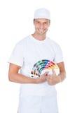 Pittore maschio With Swatch Book Fotografie Stock Libere da Diritti