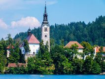 Stunning view on Maria church on little island in Lake Bled in green Sloveniaon sunny day stock images
