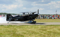 Pitts Special in smoke on a runway. Royalty Free Stock Photo