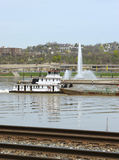 Pittsburgh Barge. Barge passing by Pittsburgh's Point Fountain with Train Tracks in Foreground Royalty Free Stock Photo