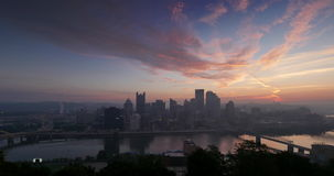 Pittsburgh Night to Day Sunrise Timelapse. A dramatic night to day sunrise time lapse of the city of Pittsburgh, Pennsylvania stock footage