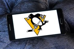 Pittsburgh Penguins ice hockey team logo. Logo of Pittsburgh Penguins ice hockey team on samsung mobile. The Pittsburgh Penguins are a professional ice hockey Stock Photo