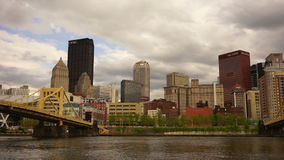 Pittsburgh Pennsylvania Downtown Urban City Skyline Monongahela River. Clouds roll by between over river and Pittsburgh PA stock video