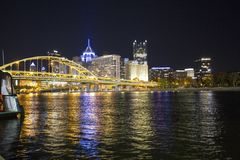 Reflections of downtown Pittsburgh along the Allegheny River at night royalty free stock image