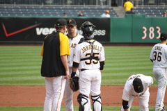 Pittsburgh Pirates' conference on the mound. Catcher Jason Jaramillo, pitcher Charlie Morton and coach Joe Kerrigan Stock Images