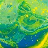 Pittura acrilica blu gialla verde di flusso Immagini Stock