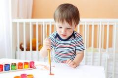 Pittura adorabile del neonato Fotografie Stock