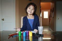 Pittura asiatica del preschooler Fotografie Stock