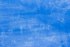 pittura blu di struttura del fondo con le macchie e schioccare in alcuni posti fotografia stock libera da diritti