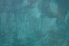 Pittura blu su una superficie di pietra, come fondo fotografia stock libera da diritti