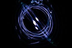 Pittura con la luce che viene dal diodo Un tiraggio a spirale del profilo immagini stock