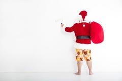 Pittura del Babbo Natale sulla parete bianca Fotografia Stock Libera da Diritti