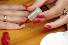 Pittura del chiodo di colore rosso Immagine Stock