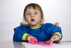 Pittura del dito della pittura della bambina Immagini Stock
