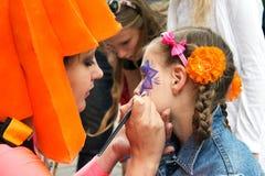 Pittura del fronte dei bambini fotografia stock