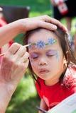 Pittura del fronte del bambino immagini stock libere da diritti