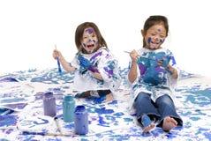 Pittura del pavimento delle ragazze di infanzia Immagine Stock