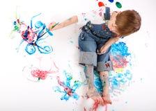 Pittura del ragazzo Immagini Stock