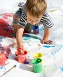 Pittura del ragazzo sopra il bianco Fotografia Stock Libera da Diritti