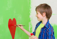 Pittura del ragazzo sulla parete Fotografia Stock Libera da Diritti