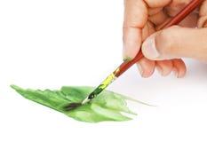 Pittura dell'artista con la spazzola Immagine Stock