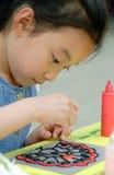 Pittura della bambina Immagini Stock