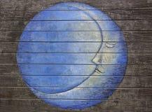 Pittura della luna blu sul pavimento di legno Fotografia Stock