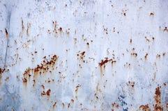 Pittura della sbucciatura su struttura arrugginita del metallo Immagine Stock