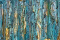Pittura di legno dorata e blu immagini stock