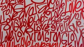 Pittura di spruzzo dei graffiti di arte della via di amore fotografia stock