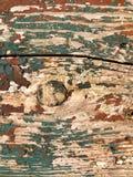 Pittura incrinata sul bordo di legno Fotografie Stock